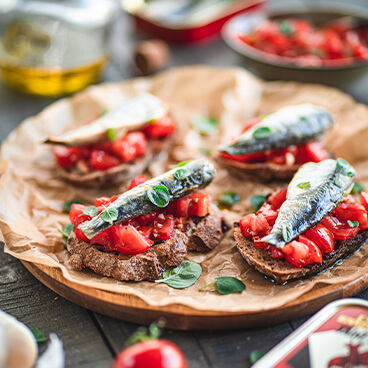 Hot buttered sardines on toast