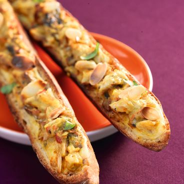 Mackerel with curry spices and almonds on toast
