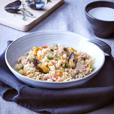 Seafood and tuna risotto with baby vegetables